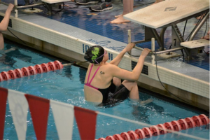 Jory Gould, 10 about to dive in for her 100 backstroke event. She swam this at the Southwest District championships. Gould practiced for the high school and is planning to do so again this. Photo courtesy of Jean Wu.