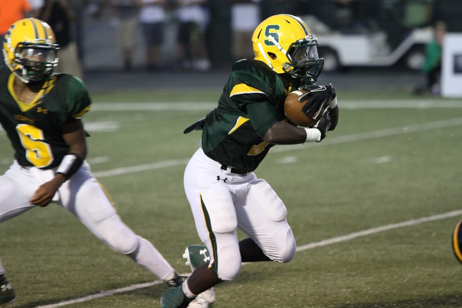 Greg Simpson hands the ball off to Solomon McMullin. Simpson did not play in the Mason game. However, SHS was able to come away with a victory.