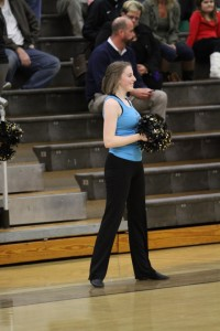 Katie Pruitt, 12 at the boys Varsity game against Mason. The team preformed at the pre-game and at halftime. The girls danced at every home game this season. Photo courtesy of McDaniel's Photography