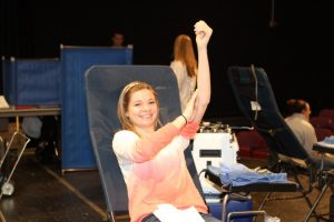 Paige Domhoff¸12 just finished donating blood to Hoxworth. The decision for SHS to host the blood drive has helped to keep the hospitals blood supply in good stock saving many lives.  Photo courtesy of McDaniel's Photography