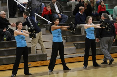 Carly Lefton 12, Rupali Jain, 12 and Katie Pruitt, 12 during pre-game at a boy's basketball game. The team lost 12 members due to graduating seniors. The returning members will have to help the new dancers over the summer. Photo courtesy of McDaniel's Photography.