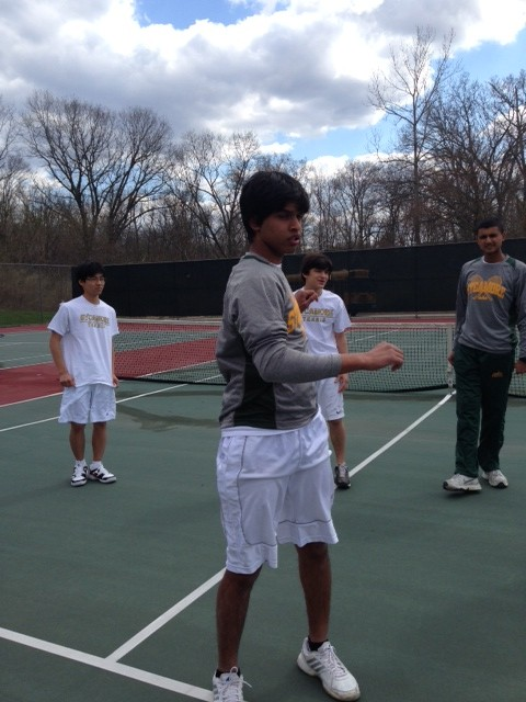 The team stretches before the match so they can be as fit as possible. Team Captain Rohan D' Souza, 10, leads the stretches. The team is getting ready to take on Turpin High School.