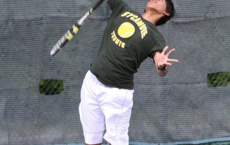 "Rohan Dsouza, 10, explodes upwards for a serve. ""This year is going to be great. I can't wait to bond with my bros,"" said Dsouza. Tennis tryouts will begin on Mon., Mar. 10 at Western & Southern. Photo Courtesy of McDaniel's Photography."