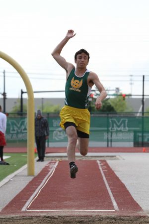 John Vuotto, 12, launches himself into the air in the long jump. He finished third with a jump of 21 feet, six and one quarter inches.