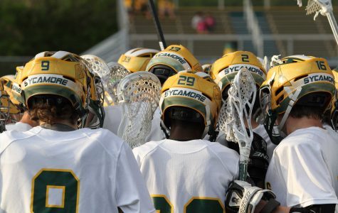 The Varsity lacrosse team huddles before a game. Spirit is a big part of the team, especially after the injuries of both Mark Reinhart, 12, and Sean Cliver, 12. The team will enter the post season tournament with a May 22 game against Springboro. Photo courtesy of McDaniel's Photography