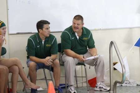 Coaches AJ Sofio and Gary Tameris instruct their players on the game. Next year both Tameris and Sofio will coach the team again. They are currently both coaching the local club team Moose water polo. (Photo courtesy of McDaniel's Photography)