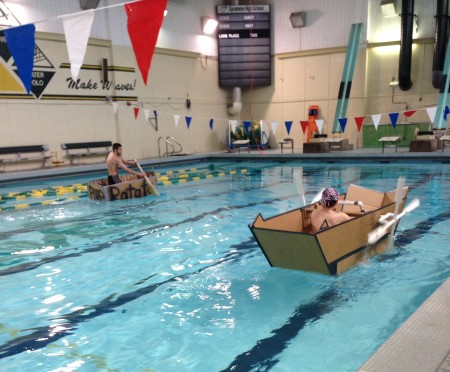 Separate bells held separate boat races, which were well attended by spectators. The boats were constructed using only cardboard, duct tape, and glue. Each boat had a theme and a name. Photo courtesy of Megan Schroeder.