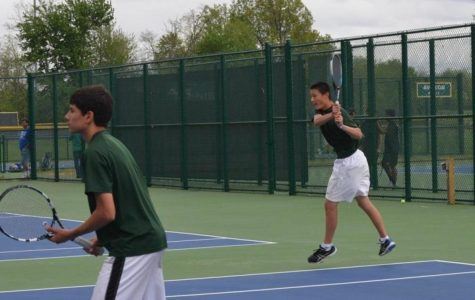 Ajay Qi, 10, drives a backhand. Qi played for multiple positions, even playing matches for the Varsity A team. Nick Hershey, 12, readies himself for a volley at the net. Photo courtesy of aves10s.net.