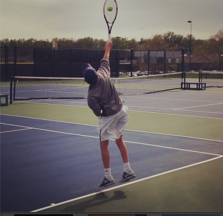 Jack Loon, 9, jumps up for a flat serve down the tee. Loon won his match at third singles with a final score of 6-2, 6-2, securing the team's 5-0 victory. This was the team's first legitimate home match of the season. Photo courtesy of Jack Loon.