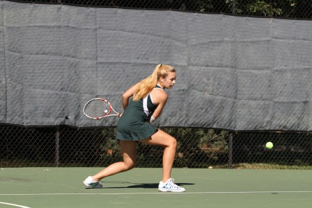 Having the new tennis facility completed causes players to be even more eager to begin playing. Clinics are offered during the summer to improve hitting technique. Members must also run the mile. Photo courtesy of McDaniel's Photography.