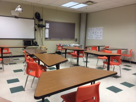 A typical classroom set up for debates.  The affirmative usually on the left side and the negative sits on the right side.  The two teams debating always face each other.  As the people debating they stand at the podium. Photo taken by Jordan Baker