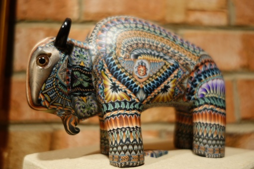 This buffalo was made by an artist who takes clay and folds it to get different shapes. Then he cuts and compresses the clay to turn them into elaborate repetitive patterns. This takes the simplicity of molding clay to a new extreme.
