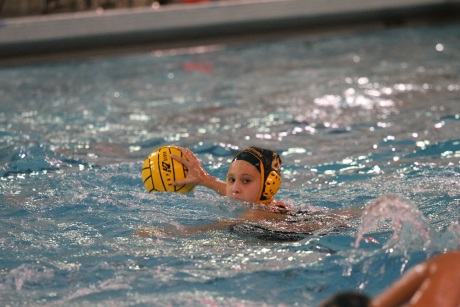 Senior Jennifer Weber looks for an open pass. Weber is a captain this year alongside junior Hannah Kast. Weber also plays for the club team Moose Water Polo and competed in the Junior Olympics in California with them this summer.