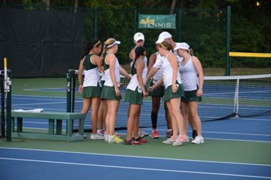 The+Lady+Aves+tennis+team+huddles+after+a+match+win+earlier+this+season.+They+lost+to+Ursuline+in+a+very+close+2-3+match.+They+are+now+out+of+the+state+team+tournament.