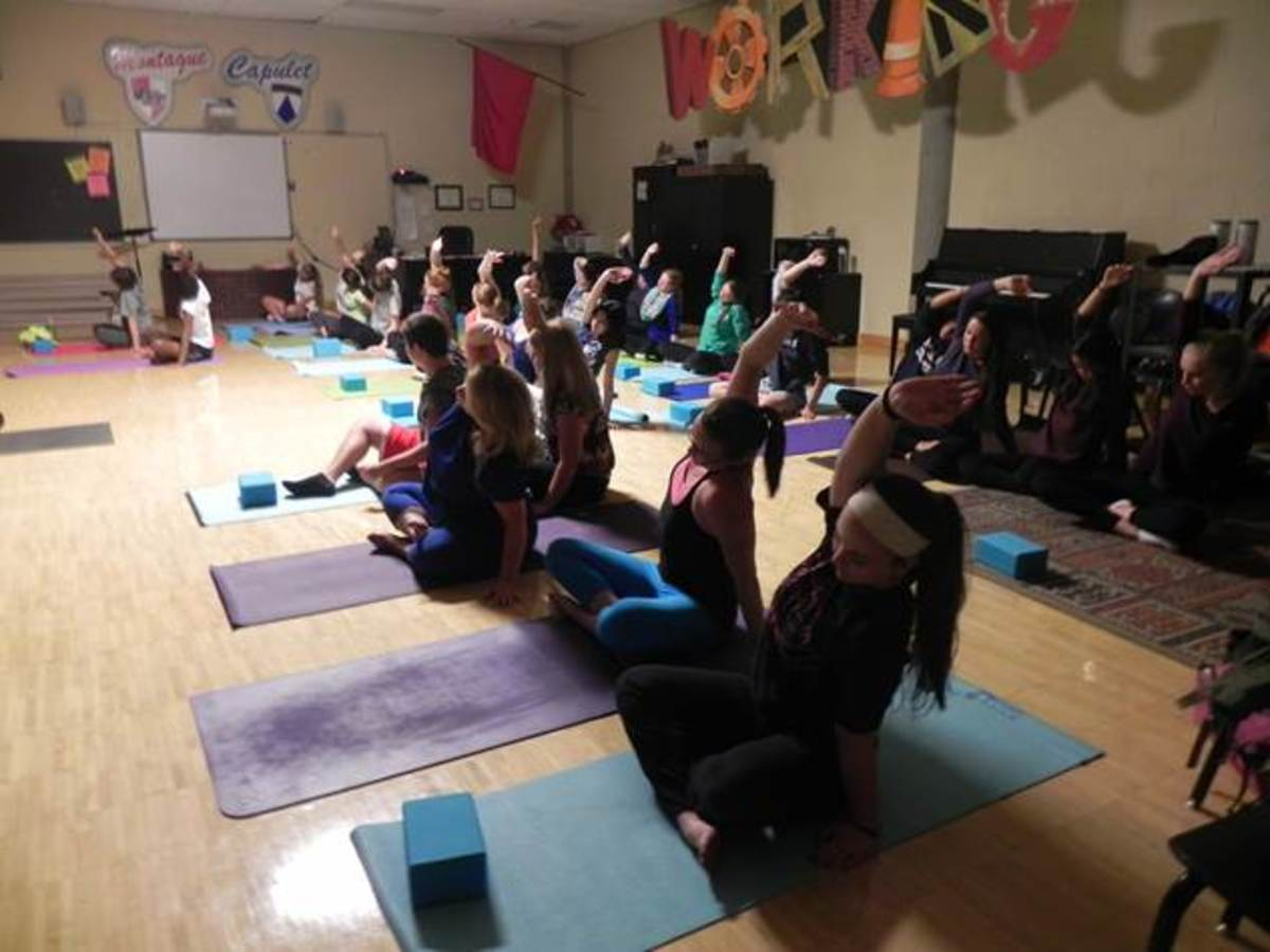 Yoga club begins its session with each individual focusing on their breathing. The club meets every Wednesday in the mirror room. The club is led by Meredith Blackmoore.