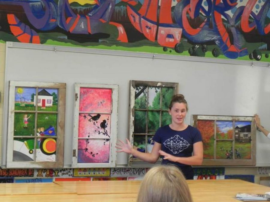 Katie+McElveen%2C++a+student+from+Loveland+High+School%2C+speaks+at+Art+Club.+The+club+began+today+after+school.+Their+premiere+project%2C+Windows+of+Hope%2C+involves+making+paintings+for+the+Ronald+McDonald+house.+