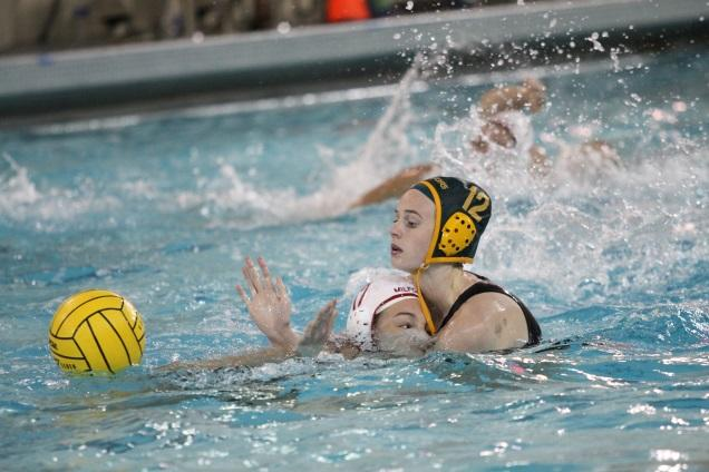 Junior+Hannah+Kast+plays+defense+against+an+opponent+from+Milford+High+School.+Kast+was+a+part+of+the+2012+and+2013+water+polo+teams+at+SHS+who+both+got+second+in+the+state.+She+always+plays+for+the+club+team+Moose+Water+Polo.+