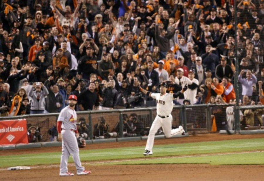 Travis+Ishikawa+celebrates+after+hitting+a+walk-off+three-run+home+run+to+send+the+Giants+to+the+World+Series.+The+Giants+have+won+the+World+Series+two+of+the+past+four+years+%28in+2010+and+2012%29%2C+and+are+looking+for+their+third+championship+in+the+last+five+years.+