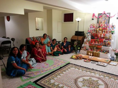 Women and girls traditionally sit on the floor, facing the dolls. People can come up and sing traditional Indian songs. The family and friends attending also wear traditional clothing.