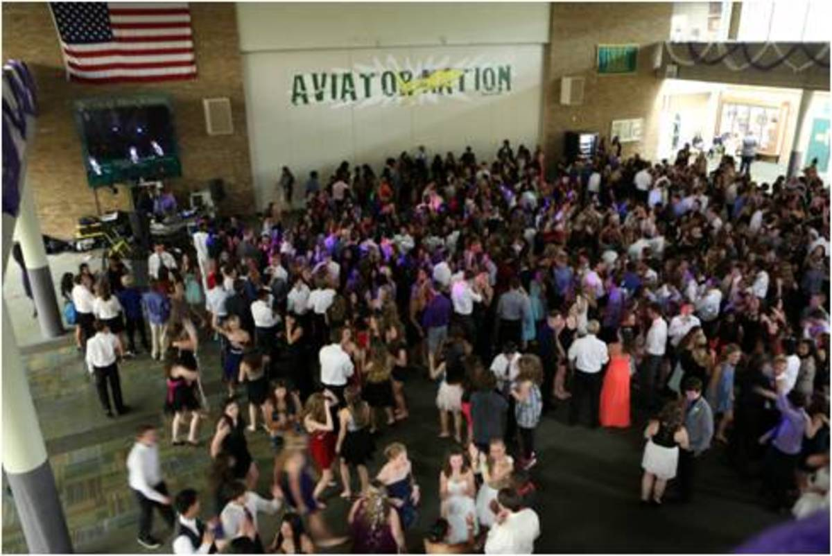 The floor of the commons was packed with students during the Homecoming dance. New features this year included a coat checking option where students could store their bags and shoes in the gym, if desired. However, old changes, like the locker bay areas being completely shut off, were kept in place this year.
