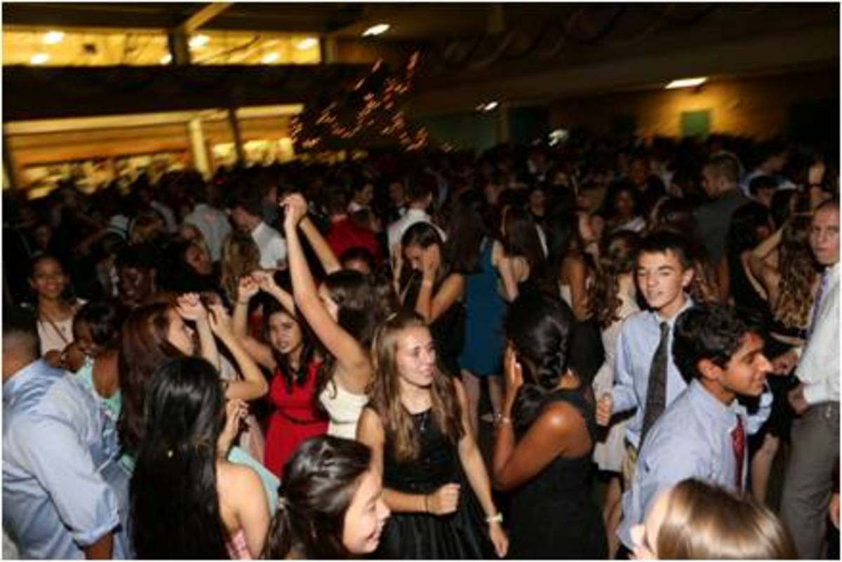 A group of students party hard to the music being played at the Homecoming dance. In past years, grinding has been heavily discouraged, but no such measures were put in place or mentioned before this year's dance. However, teachers and parent volunteers were still on hand to block exits, hand out water, check bags and moderate events.