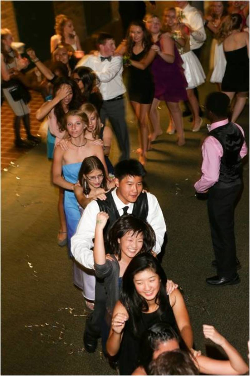"A conga line of students formed as the Homecoming dance progressed. DJ ""Fast Eddy,"" or as most students know him, Mr. Eddie Clark, was on hand to provide music. Students were able to jam out to both current pop hits and throwback songs."