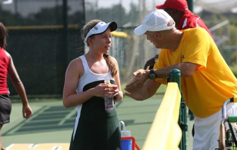 Alexa Abele plays a match against Princeton at SHS. She receives advice from Coach Mike Teets during a changeover. Sycamore beat Princeton 3-1 at the end of the day.