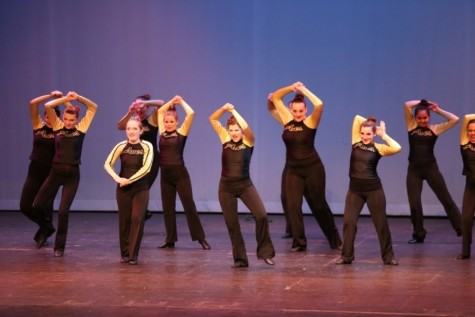 """The Flyerettes are working on a hip hop routine. """"Hip hop is my favorite style of dance because it is upbeat and we get to dance to popular songs,"""" Bird said. They danced in front of the school on Oct. 10."""