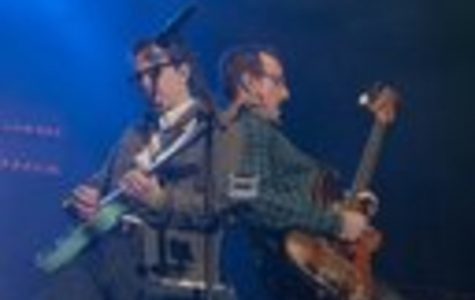 """Rivers Cuomo and Scott Shriner of Weezer play back-to-back at a concert in Ontario. Their new album, """"Everything Will Be Alright in the End"""", has been a huge success with their fans. The band hopes to continue to appease their audience moving forward."""