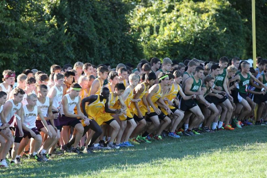 The+boys%E2%80%99+cross+country+team+starts+a+race+in+one+of+their+meets.+Although+they+did+not+reach+their+goal+of+going+to+state+they+enjoyed+their+season+together.+A+large+part+of+the+team+will+return+for+Indoor+track+in+the+winter+and+track+in+the+spring.+Photo+courtesy+of+McDaniel%E2%80%99s+Photography.+