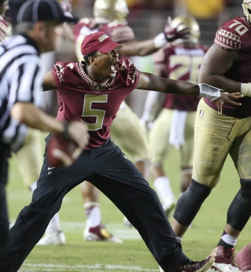 Jameis+Winston+during+the+Clemson+game+coming+on+to+the+field+to+celebrate.+He+was+suspended+from+this+game+for+yelling+obscene+comments.+He+tried+to+come+out+in+his+pads+but+was+sent+back.+