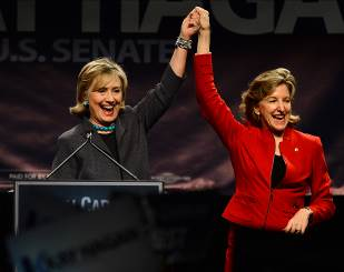 Hillary Clinton with Senator Kay Hagan following her speech at an early voter event in Charlotte. Such events promote voting while increasing visibility of female politicians. Clinton has spoken at many of these events on her national campaign circuit.