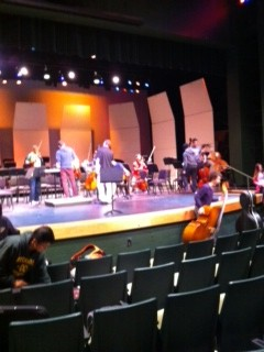 Orchestra practices in the little theater for the Senior Spotlight concert. Orchestra and certain concert band members practiced in the theater a few days before the concert to get used to the sound on stage. However, seniors soloing have been preparing their pieces for months, and cannot wait to show their hard work to parents and peers.