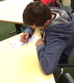Freshman Zachary Sheehan takes a Scantron test. Most classes took their pre-tests on Scantrons, like the class in which Sheehan took his test. Though teachers easily graded these Scantrons, they, along with students, still feel that pre- and post-tests are a waste of time.