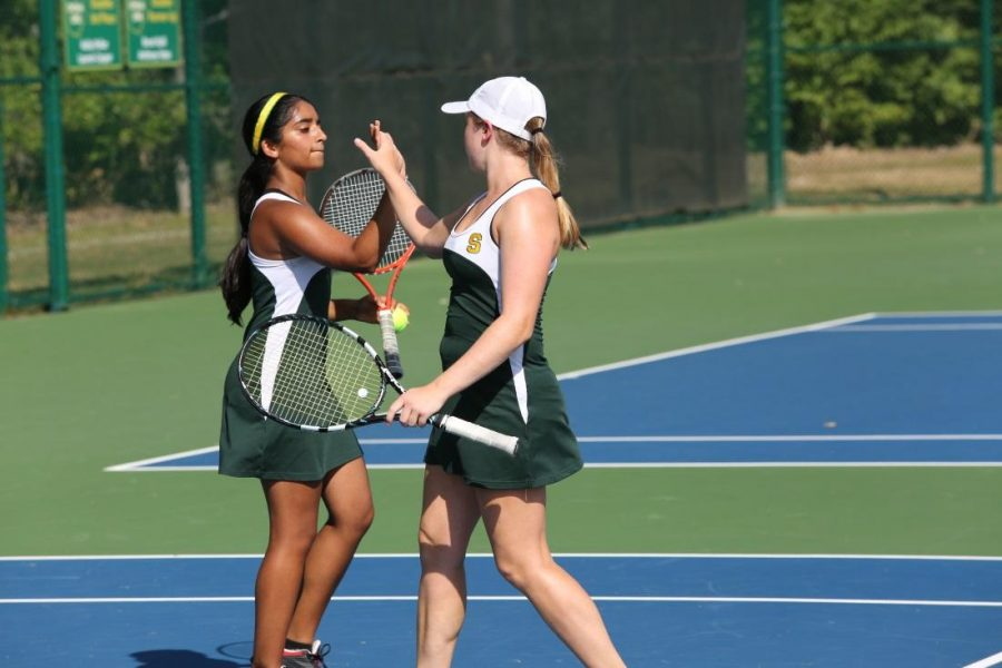 Doubles+team+Sneha+Rajagopal+and+Brianna+Dooley+congratulate+each+other+after+winning+a+point+against+the+Princeton+team.++They+do+this+after+every+point+to+emphasize+their+teamwork+and+energy.++