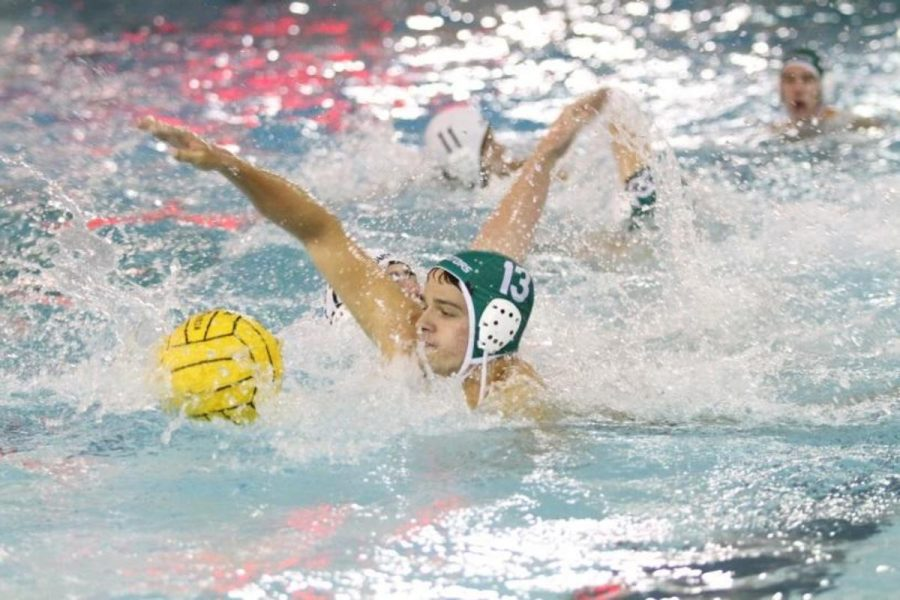 Senior+Mark+Hancher+reaches+to+steal+the+ball.+Hancher+was+one+of+the+captains+this+year+alongside+Ioas.+As+well+as+water+polo%2C+Hancher+swims+for+SHS+and+for+BASH%2C+a+local+club+swimming+team.+Photo+courtesy+of+McDaniel%E2%80%99s+photography.+
