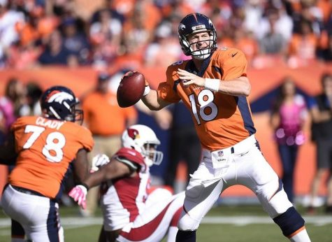 Peyton Manning drops back to throw in the first quarter of Denver's 41-20 win over the Cardinals Sunday, Oct. 5, 2014 at Sports Authority Field at Mile High.