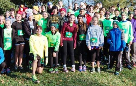 Coach Richard Shomo and all former, current, and future junior high cross country runners pose at the annual Younglife Gobble Gobble 5k. The 5k attracts families from across the community. It is not too late to sign up. Photo Courtesy of Richard Shomo.