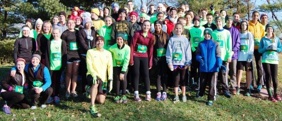 Coach+Richard+Shomo+and+all+former%2C+current%2C+and+future+junior+high+cross+country+runners+pose+at+the+annual+Younglife+Gobble+Gobble+5k.+The+5k+attracts+families+from+across+the+community.+It+is+not+too+late+to+sign+up.+Photo+Courtesy+of+Richard+Shomo.+