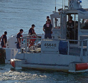 Coast Guard officers head out to rescue a capsized boat off of Miami, Florida on 0ctober 16, 2013.  Four people drowned, 11 were rescued. Aside from sea emergencies, the Coast Guard is also responsible for port safety checks, stopping drugs smuggled in by boats from reaching ports, inspecting cruise vessels, and assisting and saving people. Photo courtesy of MCT Photo.