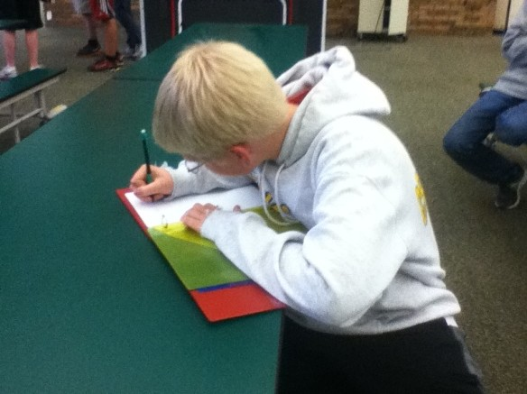 Freshman Quinn Rile desperately attempts to finish some history notes. Rile has taken all accelerated classes since he was in sixth grade. He was also about to run in a cross country meet, making his schedule extremely packed.