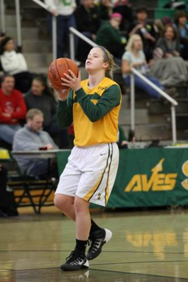 Varsity+and+sophomore+basketball+player+Renee+Foster+involves+herself+in+multiple+school+activities+including+soccer+and+basketball.+Through+her+experiences+as+an+athlete+she+has+been+molded+to+be+a+great+team+player+and+works+well+with+others+on+and+off+the+court.+