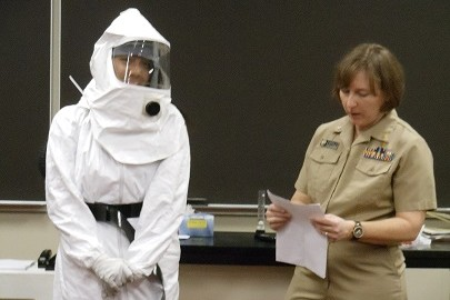 Freshman Leah Wallihan is dressed in a hazmat suit worn by nurses and other health officials who work with Ebola patients.  Estill walked through the precautions that are taken with gearing up.  She also discussed the steps with donning and doffing the suit.