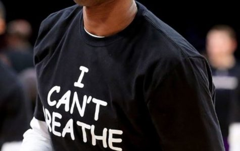 """Kobe Bryant and the rest of the Lakers, decided to wear the """"I Can't Breathe"""" t-shirts during warm-ups. These shirts have been seen all over the NBA and have become a movement to anyone wishing to support Eric Garner. Photo Credit: MCT Photo"""