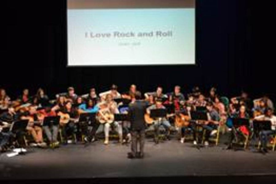 Guitar+1+students+participated+in+their+first+recital+during+seventh+bell+today.+One+song+was+written+by+students+and+the+second+half+of+the+concert+featured+sing+along+songs+such+as+%27I+Love+Rock+and+Roll%27+by+Joan+Jett.+The+students+were+joined+by+orchestra+members+Emma+Burge%2C+Nora+Dukart+and+Shoyo+Hakozaki.