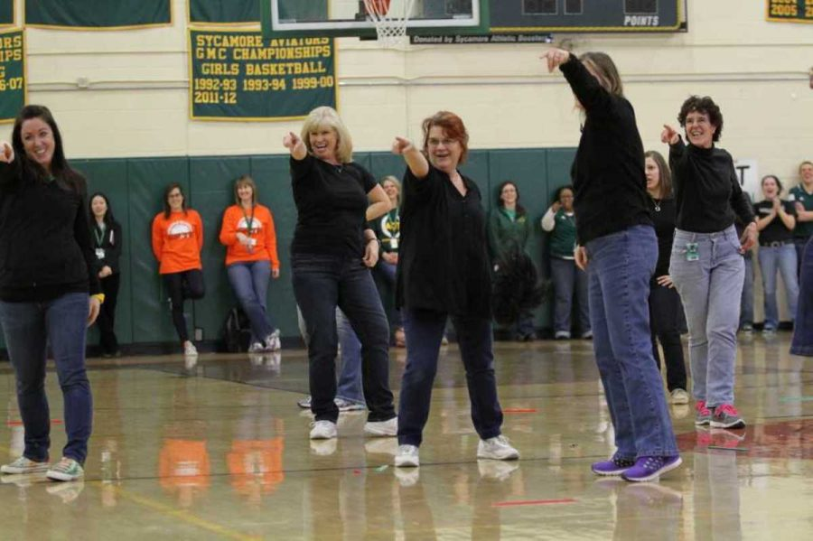 A group of female teachers danced to a parody of 'Shake it off' by Taylor Swift. The parody was about teaching and students texting in class. The performance was choreographed by art teacher Elise Williams.
