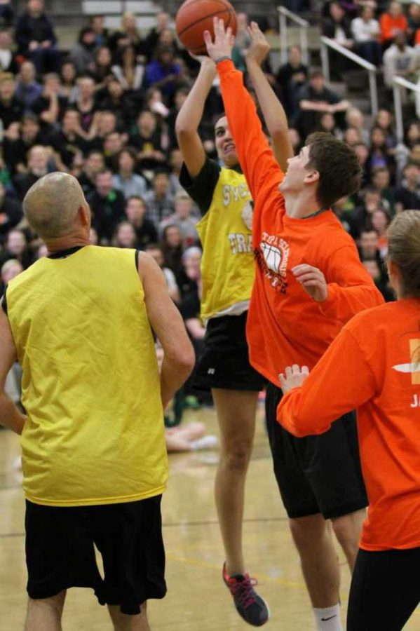 English teacher, Sofia Feist takes a shot during the student vs teacher basketball game. The teachers gave a valiant effort, including doing a half time player swap. In the end, the talented basketball star students they were up against were too tough to be beaten.