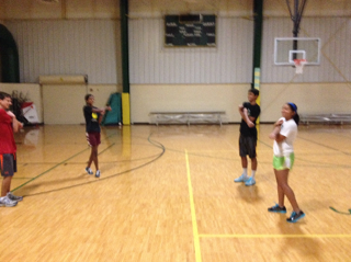 Tennis players wake up on Tues. and Thurs. for morning conditioning. They are stretching after a half hour work out.