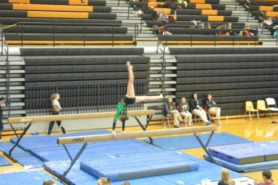 Molly+Gearin%2C+12%2C+competes+on+the+beam+at+a+recent+meet+in+Centerville.+As+a+senior%2C+this+is+Gearin%E2%80%99s+final+season+after+15+years.+Senior+night+is+Feb.+11+at+Cincinnati+Country+Day.+Photo+Courtesy+of+Molly+Gearin+