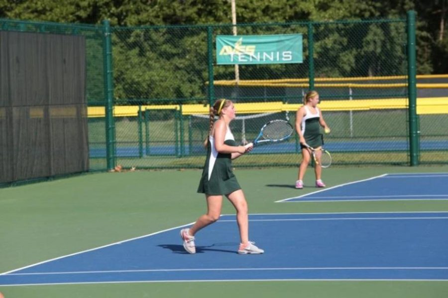 """Senior, Jamie Pescovitz steps up to hit a winner return (a really good shot that leaves the opponent unable to return).  After winning the point, Pescovitz exhibits her excitement by exclaiming """"Let's go!"""""""